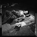 Navy photographer pictures suffering and ruins that resulted from atom bomb blast in Hiroshima, Japan. Victim lies in... - NARA - 520933.tif