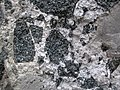 Obsidian clast breccia (Nez Perce Creek Flow, ~152 ka; Firehole Canyon roadcut, Yellowstone, Wyoming, USA) 11 (20298102652).jpg