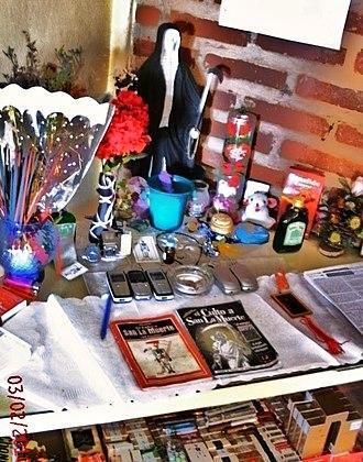 San La Muerte - Cigarette and cell phone offerings to San La Muerte in central Argentina.