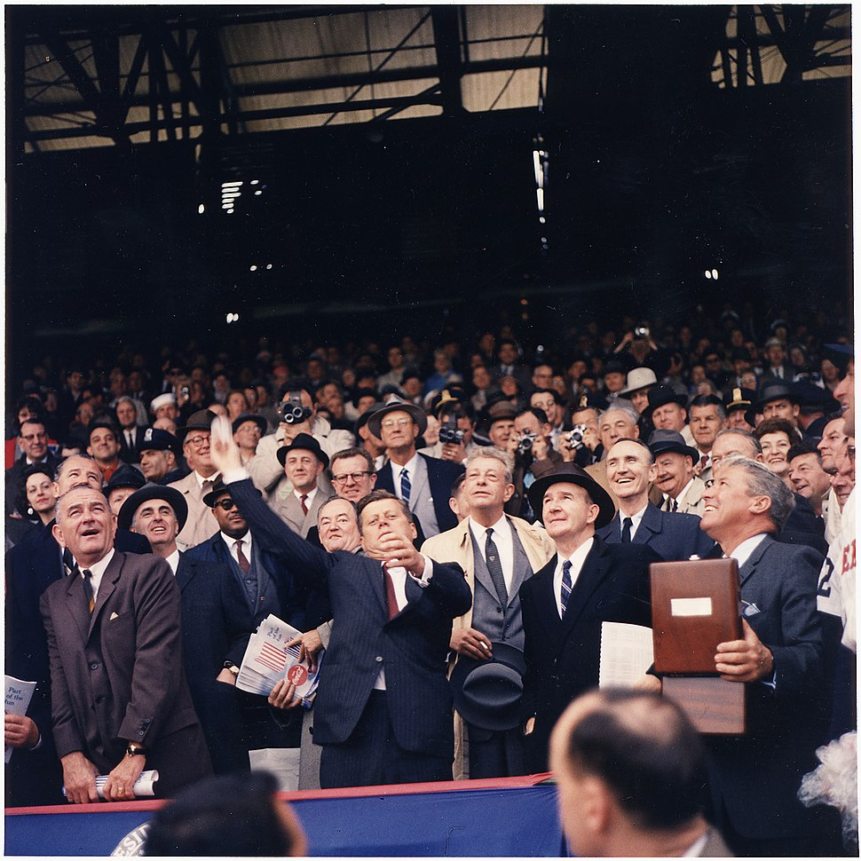 Opening Day of 1961 Baseball Season. President Kennedy throws out first ball. (first row) Vice President Johnson... - NARA - 194197