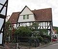 """Ortstypischer """"Dreiseithof"""" Strauß - Hofseite des Fachwerkwohnhauses von 1806 - Meinhard-Grebendorf Sandstraße 23 - panoramio.jpg"""