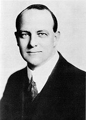 Black and white photograph of Wodehouse's head and shoulders. He is wearing a suit and looking at the camera
