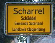 A bilingual sign, the second line shows the place name in Sater Frisian