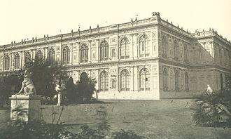 Palacio de la Exposición - Exterior of left lateral and posterior parts of the Palacio de la Exposición. It can see one of the statues of animals that adorned.
