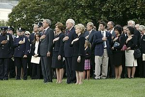 President George W. Bush and Vice President Dick Cheney on September 11, 2004 lead a moment of silence on the South Lawn with White House staff and families of victims of 9/11.