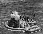 Pete Conrad (left), Dick Gordon, U.S. Navy pararescueman Lt. (J.G.) Ernest Lee Jahncke, III, and Al Bean in the recovery raft. Jahncke is signalling the recovery helicopter.jpg