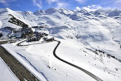 A view of Peyresourde, Hautes-Pyrénées with a ski slope at the resort of Peyragudes.