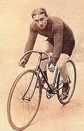 A man sitting on a bicycle