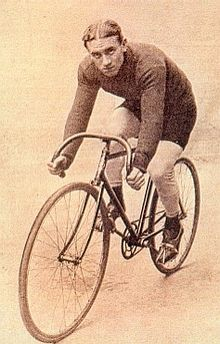 A man sitting on a bicycle.