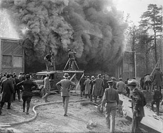 Hearst Metrotone News - A Hearst Metrotone News crew filming a fire.