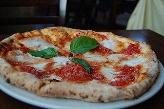 Pizza Margherita Pizza topped with tomato, mozzarella, and fresh basil