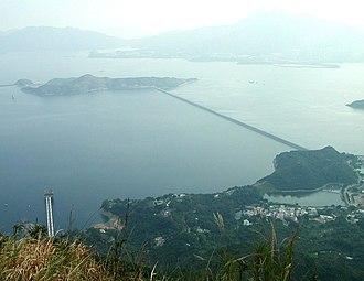 Plover Cove Reservoir - Main dam. Bottom right: Tai Mei Tuk.