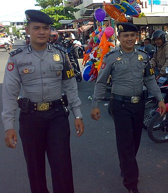 Law enforcement in Indonesia - Two Indonesian policemen patrolling the streets