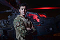 Portrait of an Apache pilot, standing in front of his attack helicopter. MOD 45156060.jpg