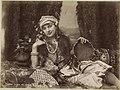 Portret van een Turkse vrouw met tamboerijn in de hand, liggend op een divan Princesse turque sur le divan (titel op object), RP-F-F01161-AL.jpg