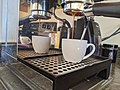 Pulling a triple espresso shot with a naked portafilter, view from the bottom.jpg