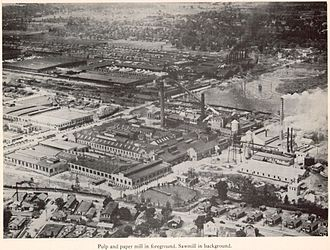 Charles W. Goodyear - Pulp and paper mill in foreground at Bogalusa, Louisiana,  sawmill in background