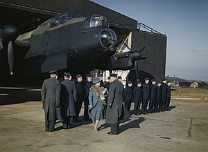No. 156 Squadron RAF - HM Queen Elizabeth inspects flight and ground crews at RAF Warboys, February 1944, in front of an Avro Lancaster of No. 156 Squadron