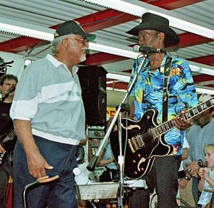 "Wardell Quezergue - Quezergue (left) greeting Clarence ""Gatemouth"" Brown, New Orleans, 1997"