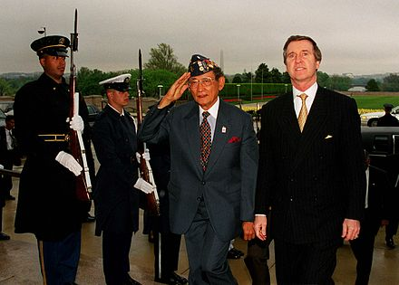 President Fidel V. Ramos salutes at the Pentagon with U.S. Secretary of Defense William Cohen and an honor guard during a State visit in 1998. - Philippines