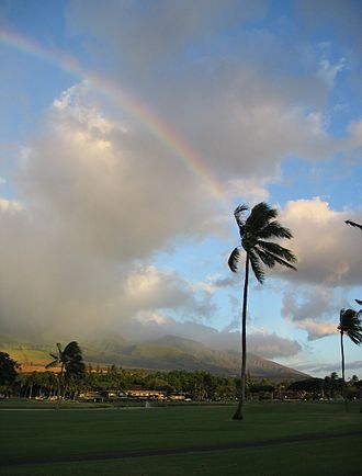 Maui - Rainbow over the West Maui Mountains after rainfall in Kā{{okina}}anapali