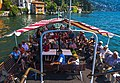 Rear deck of Lake Como ferry, with passengers.jpg