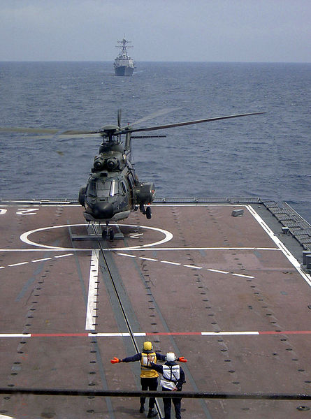 File:Republic of Singapore Air Force Eurocopter AS332 Super Puma taking off from the RSS Resolution with the USS Russell on the horizon - 20040607.jpg