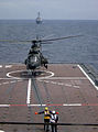 Republic of Singapore Air Force Eurocopter AS332 Super Puma taking off from the RSS Resolution with the USS Russell on the horizon - 20040607.jpg