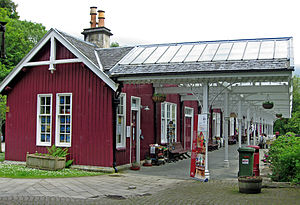 Strathpeffer railway station - The station in 2011, viewed from the west end, when in use as an information office, cafe and retail shops. The railway line lay behind the bushes at right.