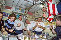 STS-110 crew eating.jpg