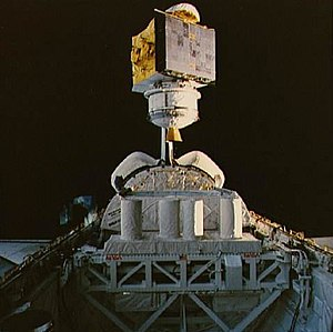 Satcom (satellite) - Satcom K1 being placed into orbit by the Space Shuttle Columbia in 1986. The illuminated (right hand) side of the satellite is one set of solar panels which were extended when the satellite propelled itself to its geostationary orbit
