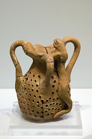 Perforated pitcher with snakes