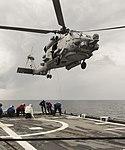 Sailors on the flight deck of USS Antietam (CG-54) send up fuel samples during HSM-77's MH-60R Seahawk in flight refueling.jpg