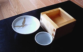 Sake set - Sake can be served in a wide variety of cups; here is sakazuki (flat saucer-like cup), ochoko (small cylindrical cup), and masu (wooden box cup).