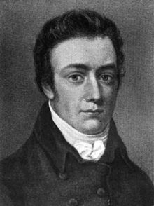 Head and shoulders portrait of a young man with short sideburns. He wears a high collar with a small bow and a coat, and is looking at the viewer.