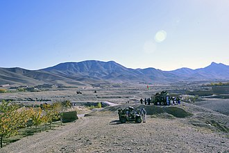 Maidan Wardak Province - A gathering of people receiving gifts from the Afghan National Army (ANA) during a patrol in the Sayedabad district of Wardak Province in November 2011