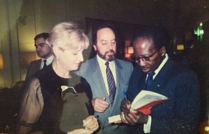 Léopold Sédar Senghor - Senghor signing a copy of his Poèmes, Universita degli Studi di Genova (18 January 1988).