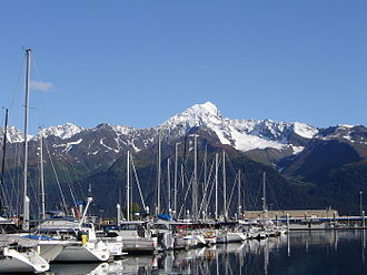 Seward, Alaska - Boats in the harbor, with the snow-capped peak of Mount Alice across the bay to the east in the background.