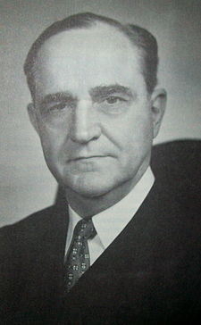 The face of a middle-aged Sherman Minton with dark hair and a prominent nose looking directly forward with a slight smile