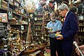 Shopkeeper Offers Oil Lamp as Secretary Kerry Pays Visit to Muttrah Souk in Oman.jpg