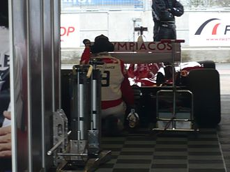 Olympiacos CFP (Superleague Formula team) - Olympiacos CFP car in the pitlane garage at Silverstone Circuit (2010)