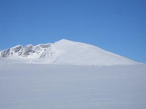 Snøhetta - Snøhetta. From the left, the peaks are Vesttoppen, Hettpiggen, Midttoppen and then Stortoppen (highest) to the right.