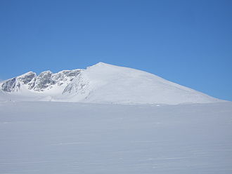 Snøhetta - Snøhetta. From the left, the peaks are Vesttoppen, Hettpiggen, Midttoppen and then Stortoppen (highest) to the right.