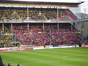 Denmark–Sweden football rivalry - Sweden fans (in yellow) and Denmark fans (in red) during a clash in 2009.