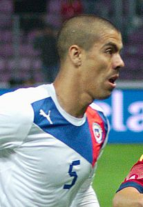 Spain - Chile - 10-09-2013 - Geneva - Francisco Silva and Andres Iniesta (cropped).jpg