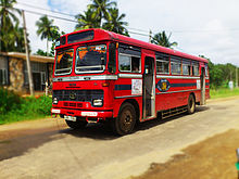 Red bus on a rural road