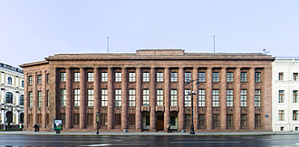 Stripped Classicism - The German Imperial Embassy (designed 1911-12) on St. Isaac's Square, Saint Petersburg, is considered the key template for Stripped Classicism. It was stripped still further when the large statues originally placed on the plinth on the roof were removed during World War I.