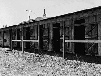 Fred Korematsu - Former horse stalls converted for temporary occupation by Japanese American internees at Tanforan Assembly Center, San Bruno, California, 1942