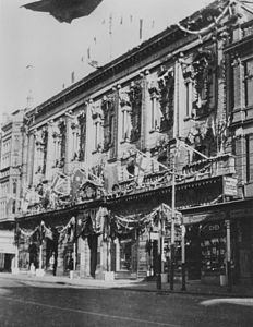 StateLibQld 1 389777 Old Town Hall decorated for the visit of the Duke and Duchess of York in Brisbane, 1927.jpg