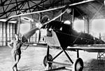 StateLibQld 2 149823 Mechanic C. R. Wilson with a De Havilland DH6 two-seater biplane, Point Cook, 1918.jpg